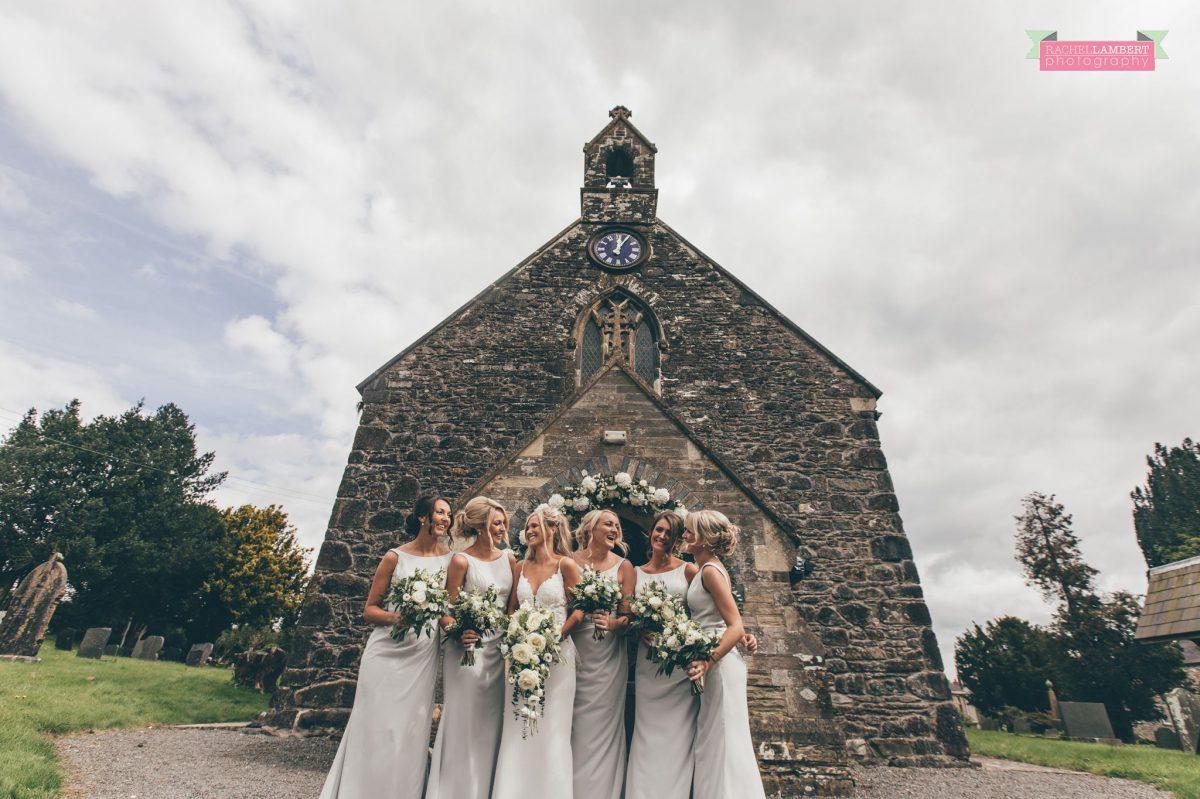 bridesmaids and bride outside church wedding