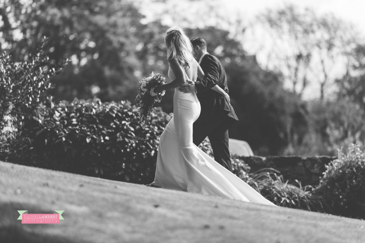 bride and groom wedding walking arm in arm black and white portrait
