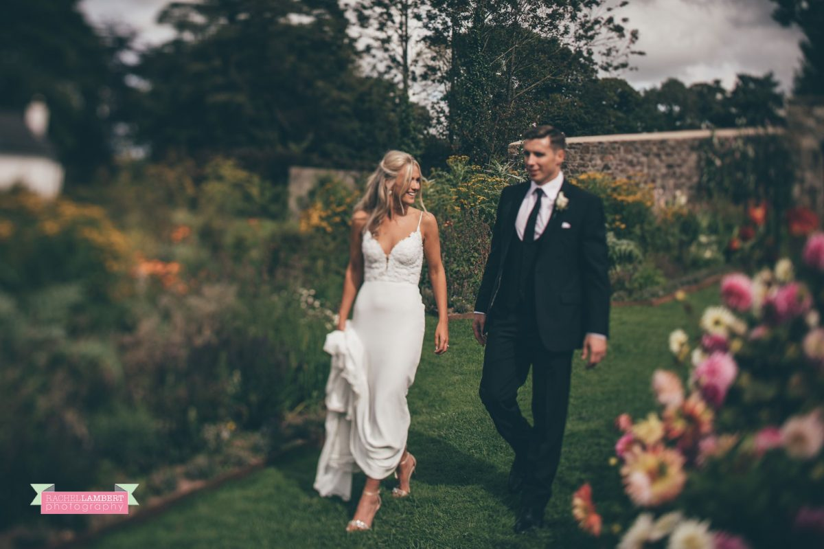 bride and groom wedding walking flower garden the grove narberth
