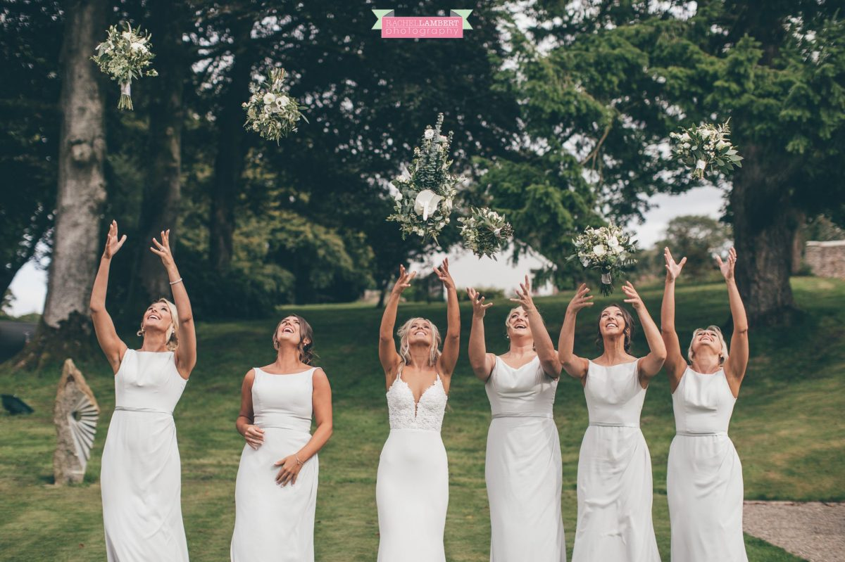 bride and bridesmaids throwing bouquets the grove nartberth