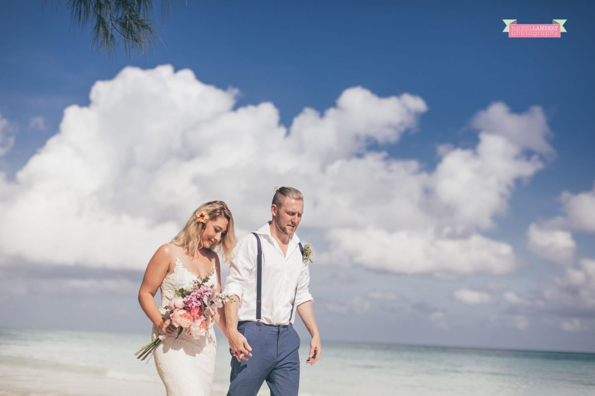 walking on beach bridal flowers bride and groom jamaica