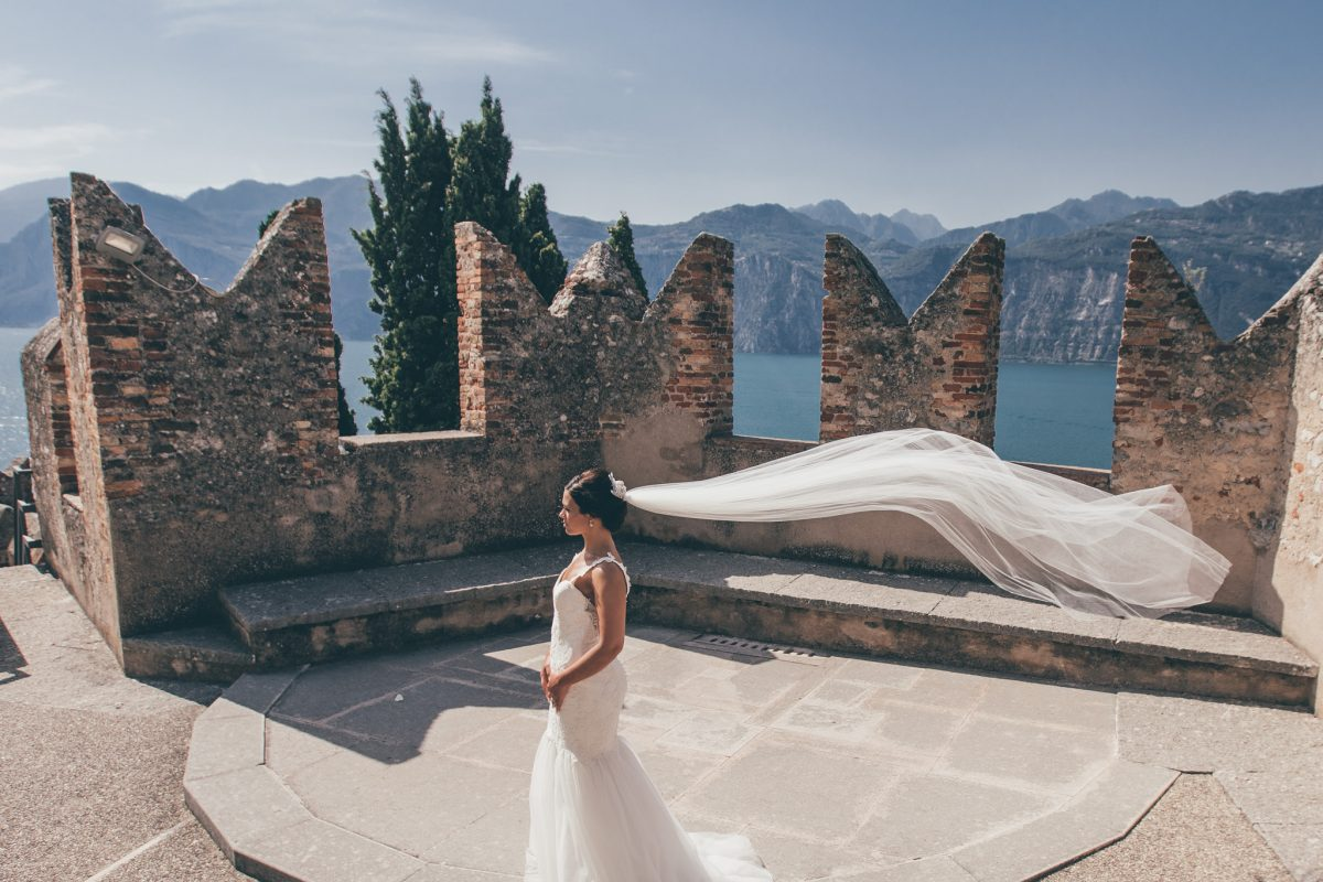 long veil shot with bride in malcesine castle lake garda italy destination wedding photographer
