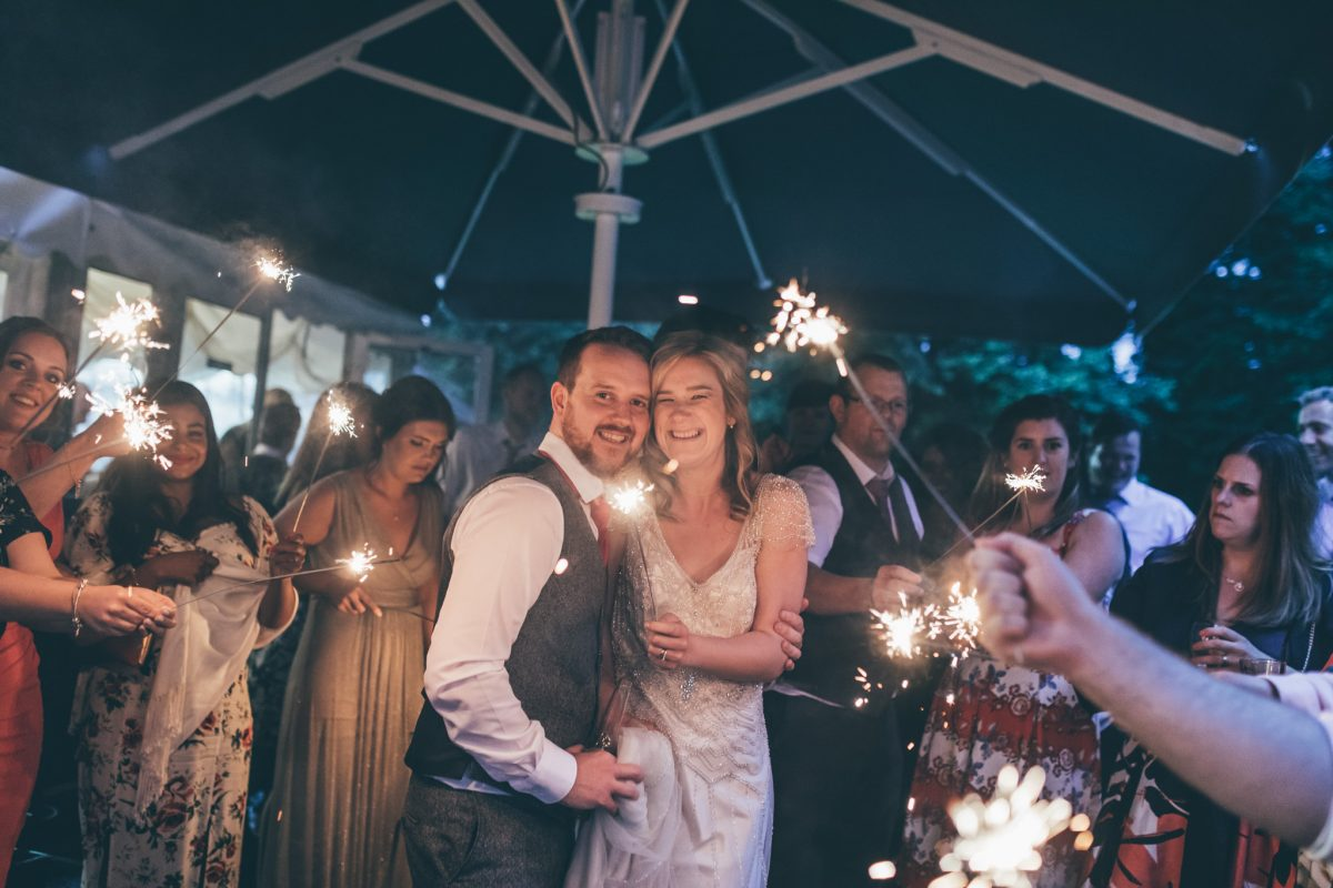 sparkler shot at pencoed house wedding venue bride and groom