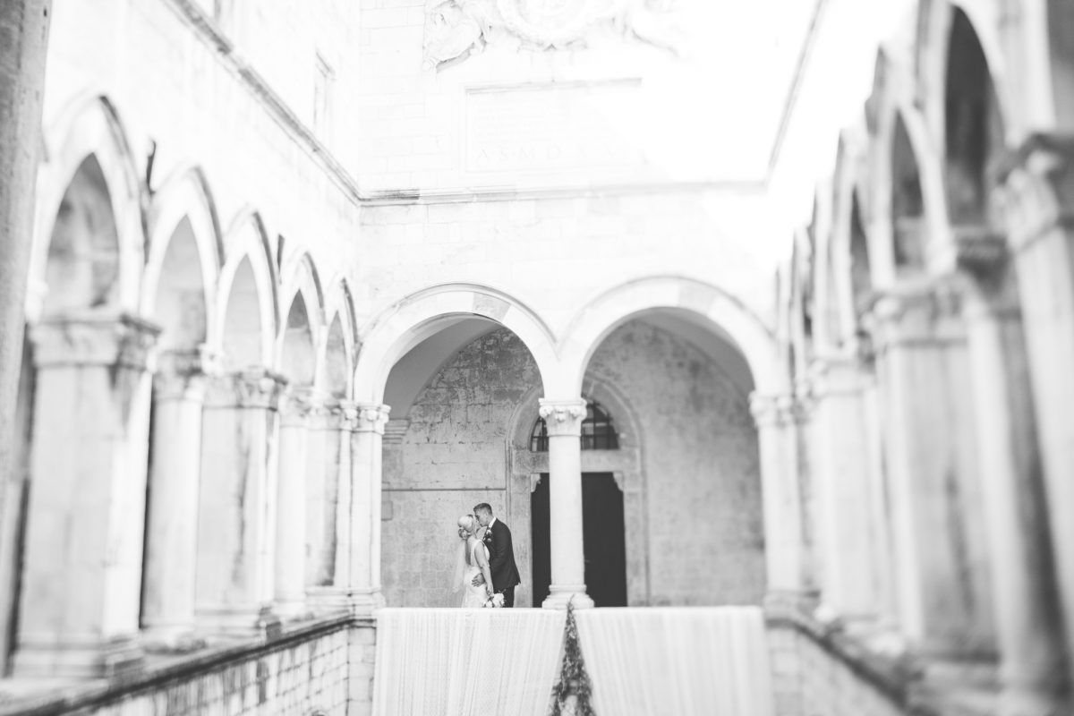 bride and groom in croatia at the sponza palace dubrovnik destination wedding photographer rachel lambert photography