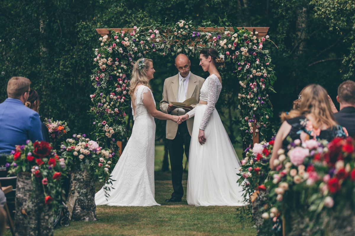 same sex wedding two brides flowers summer garden party wedding rachel lambert photography