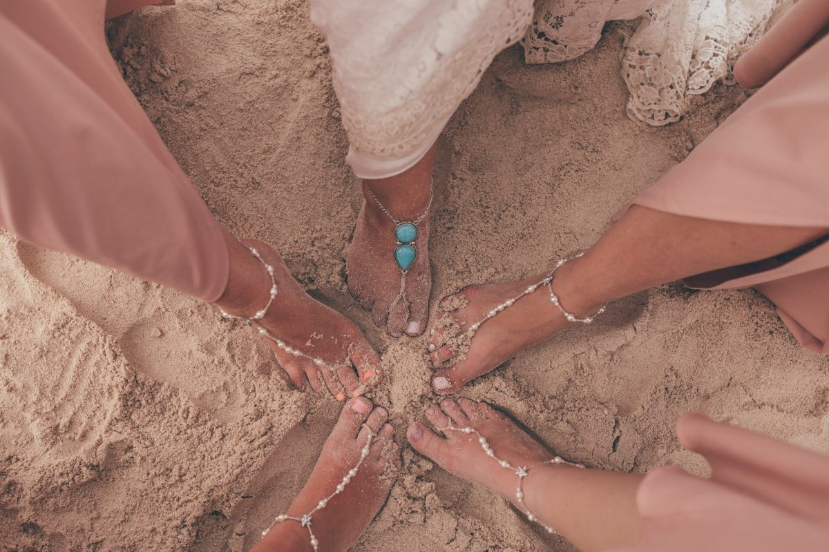 bride and bridesmaids feet in the sand in jamaica destination wedding photography rachel lambert photography