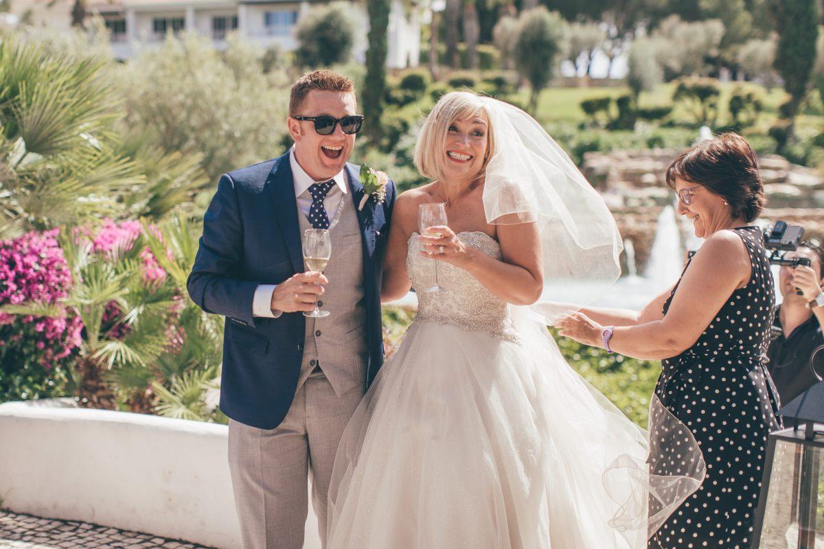 bride and groom entering reception wedding in portugal