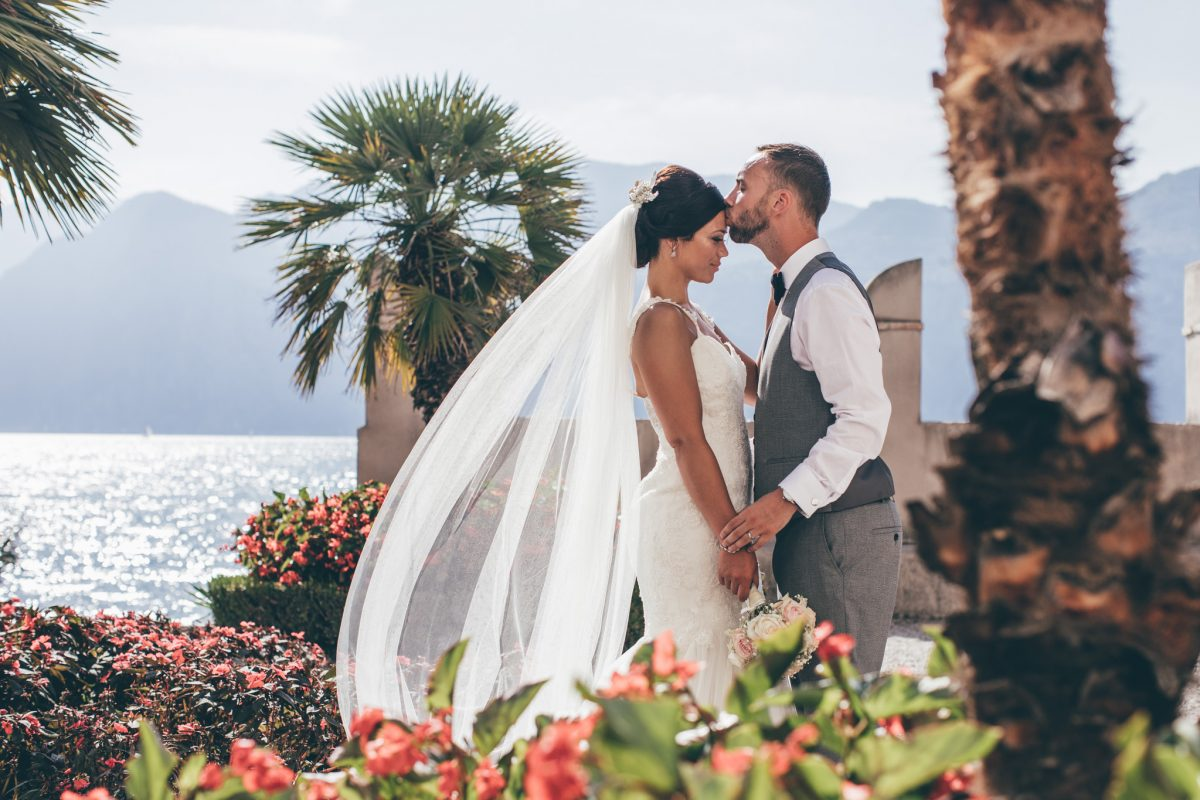 malcesine castle summer wedding bride and groom long veil rachel lambert photography