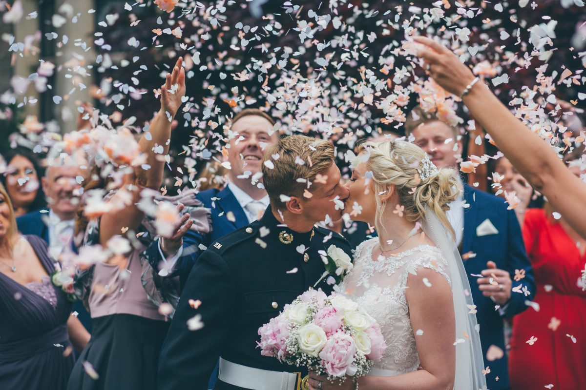 confetti shot at miskin manor with guests and bride and groom rachel lambert photography