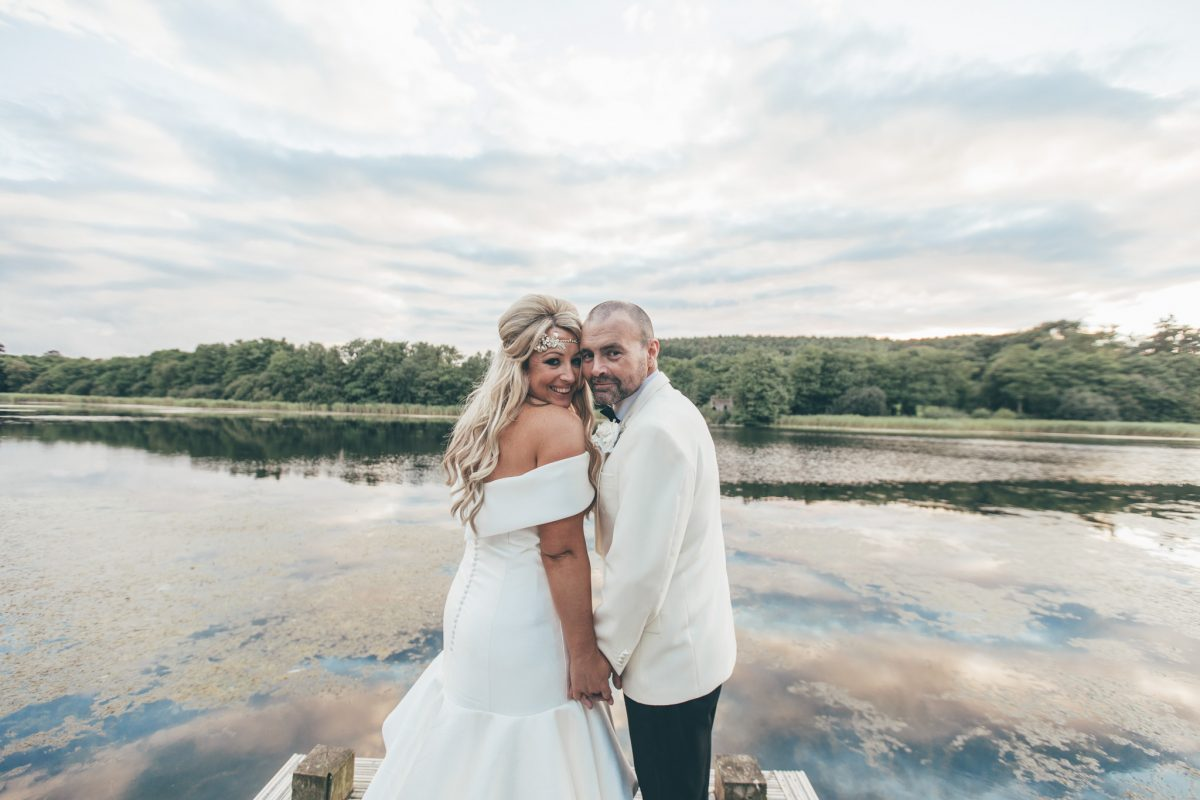 bride and groom by the lake at hensol castle wales rachel lambert photography