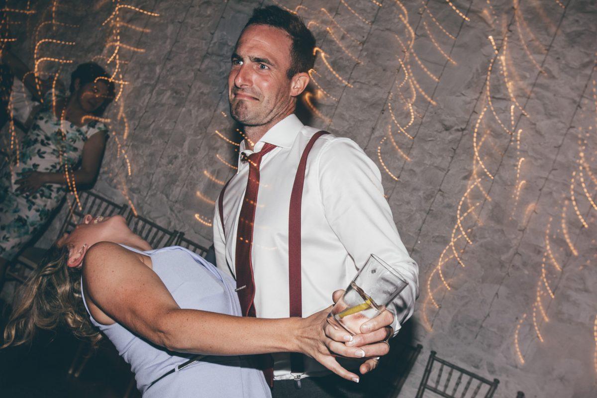 guests dancing at rosedew farm wedding venue summer rachel lambert photography light trails
