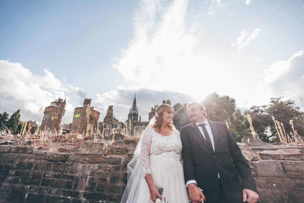 bride and groom at cardiff castle in the summer rachel lambert photography