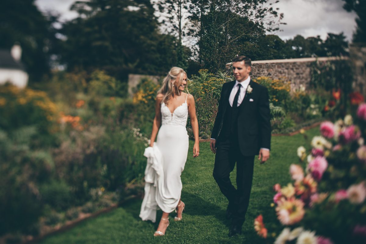 bride and groom walking through the gardens at the grove narberth summer wedding rachel lambert photography