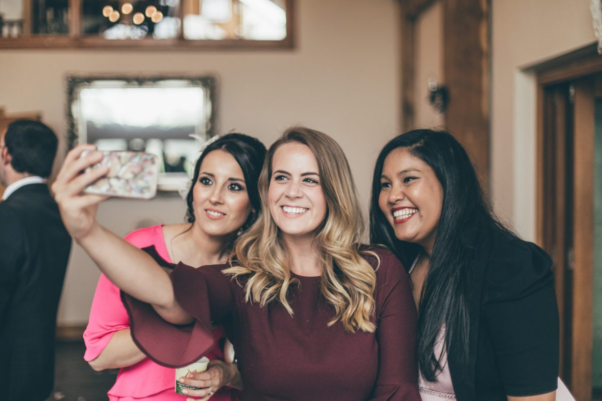 guests taking selfies at weddings oldwalls rachel lambert photography
