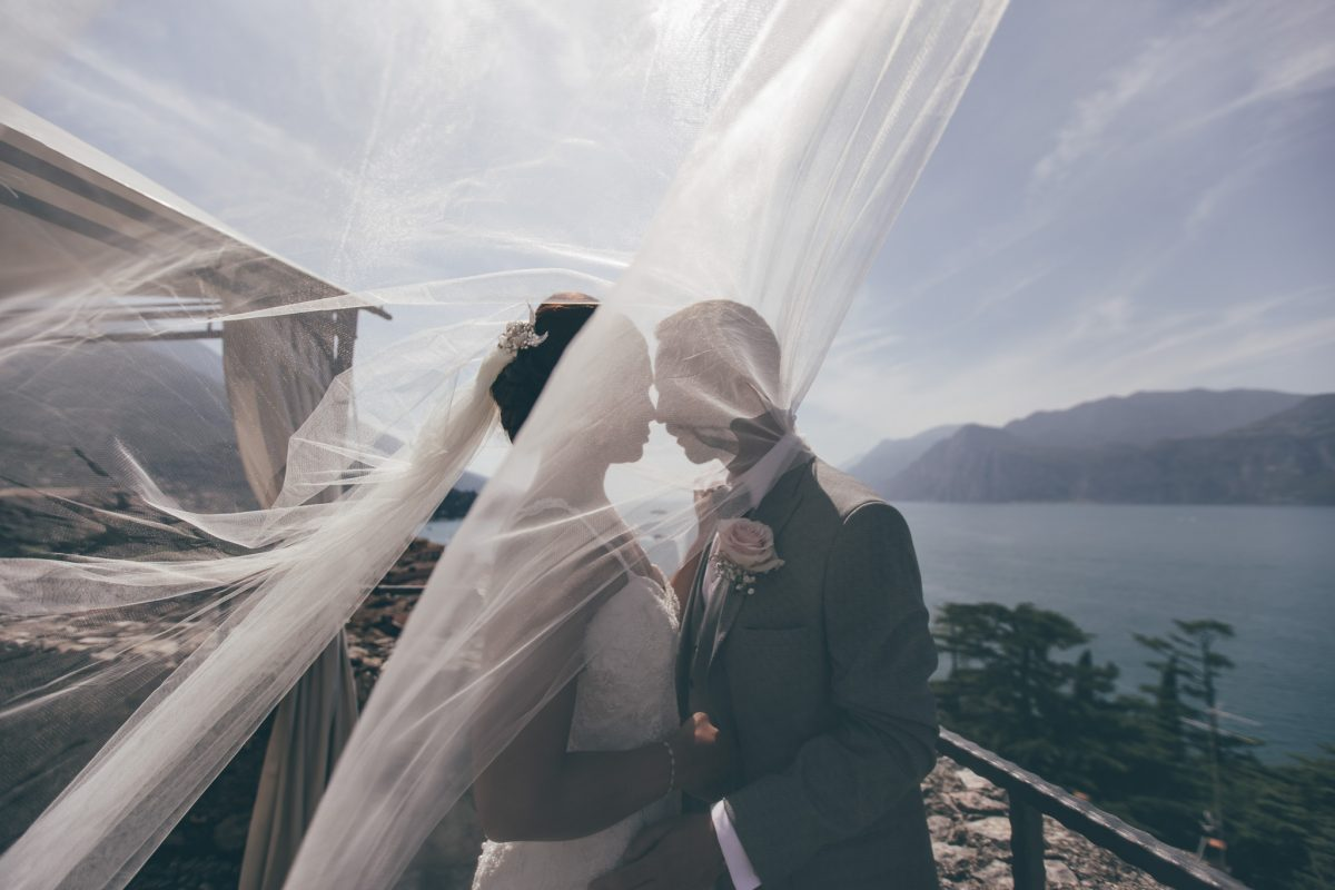 bride and groom at malcesine castle with veil rachel lambert photography