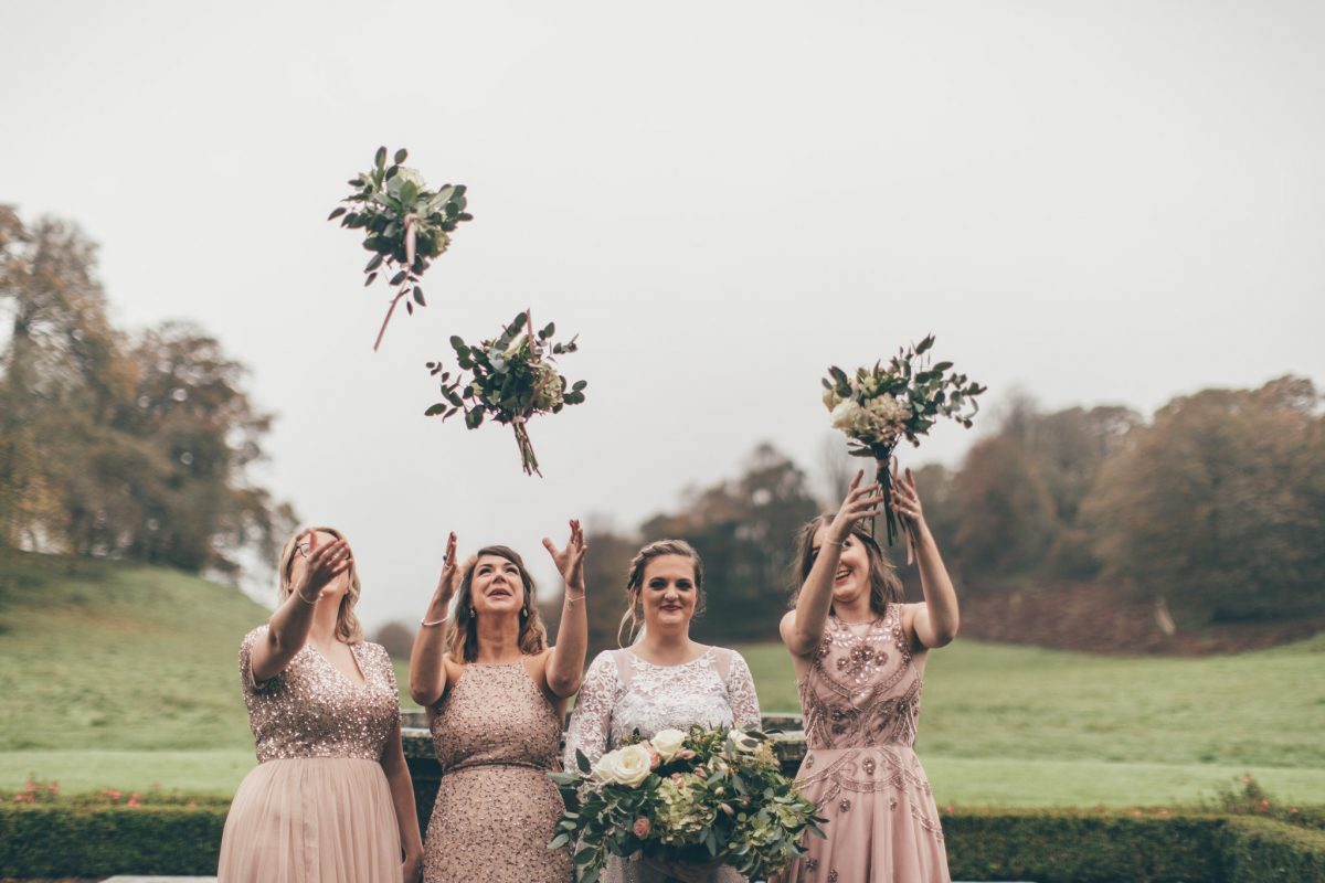 bridesmaids and bride throwing bouquet wedding at newton house llandeilo