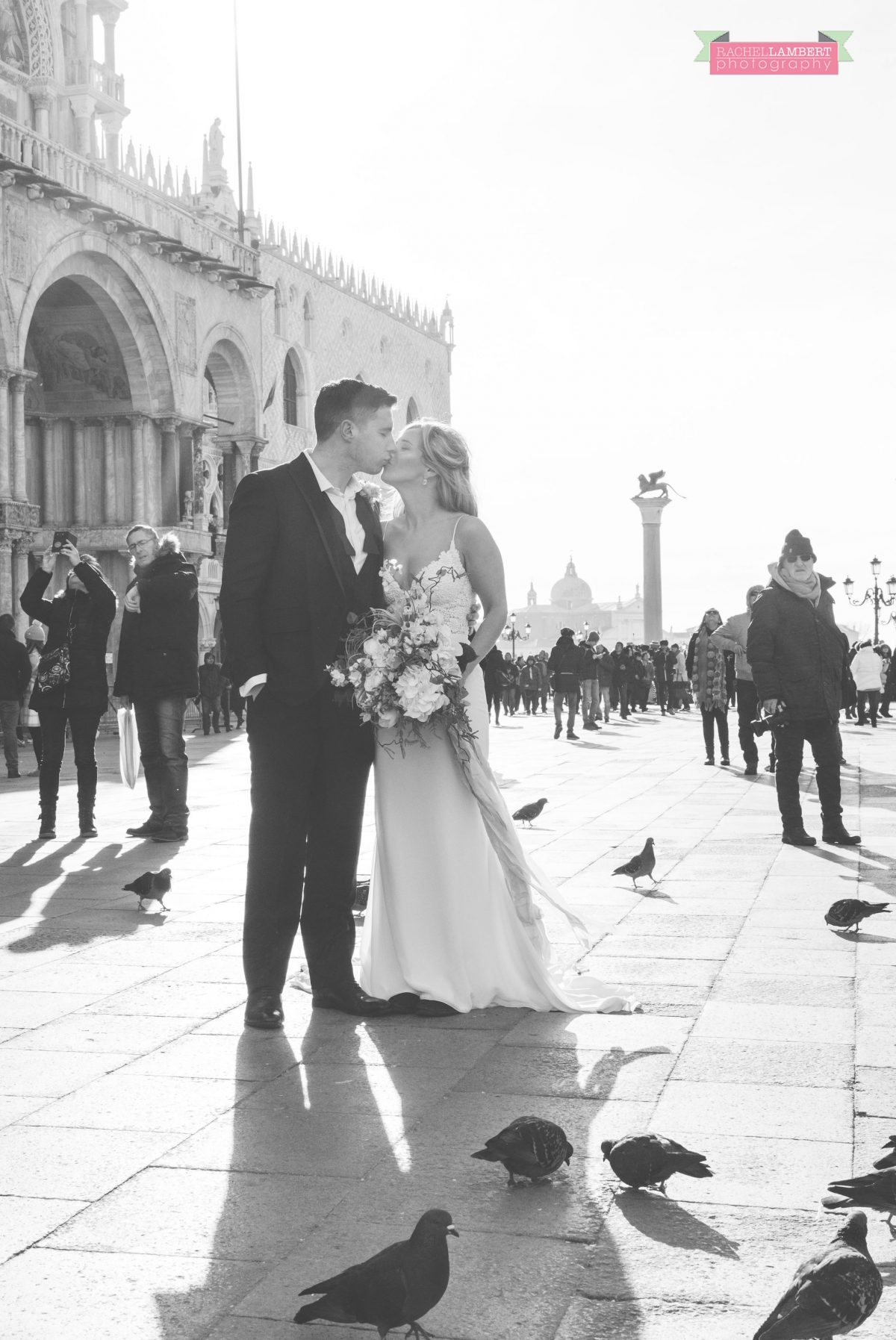 bride and groom pigeons st marks square Venice italy