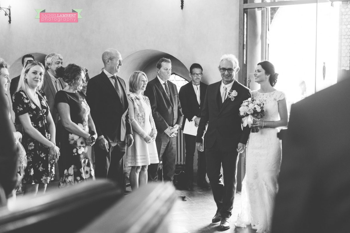 bride and groom portrait wedding in italy colour cortona tuscany black and white town ceremony bride entering