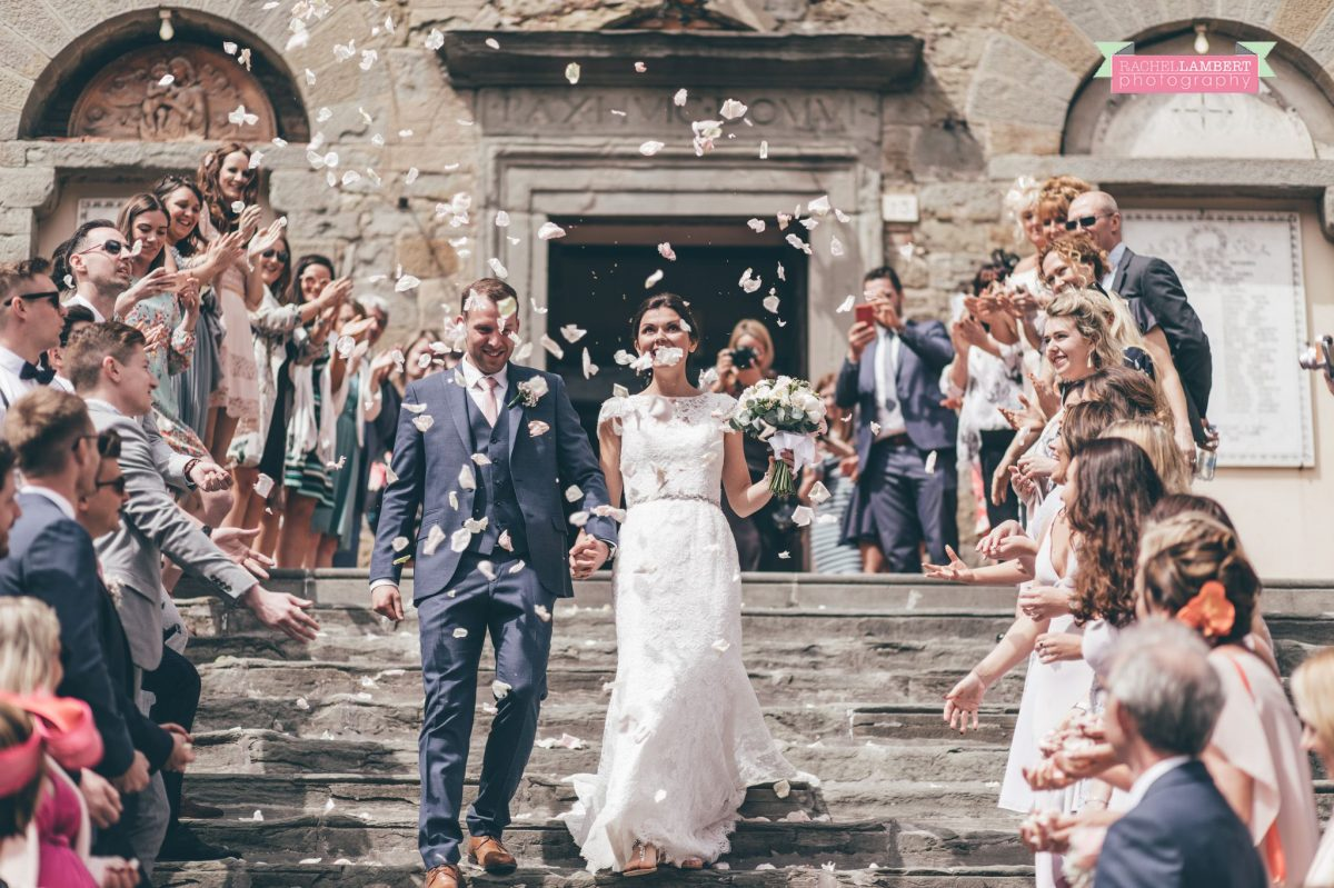 bride and groom portrait wedding in italy colour cortona tuscany confetti on steps at town hall