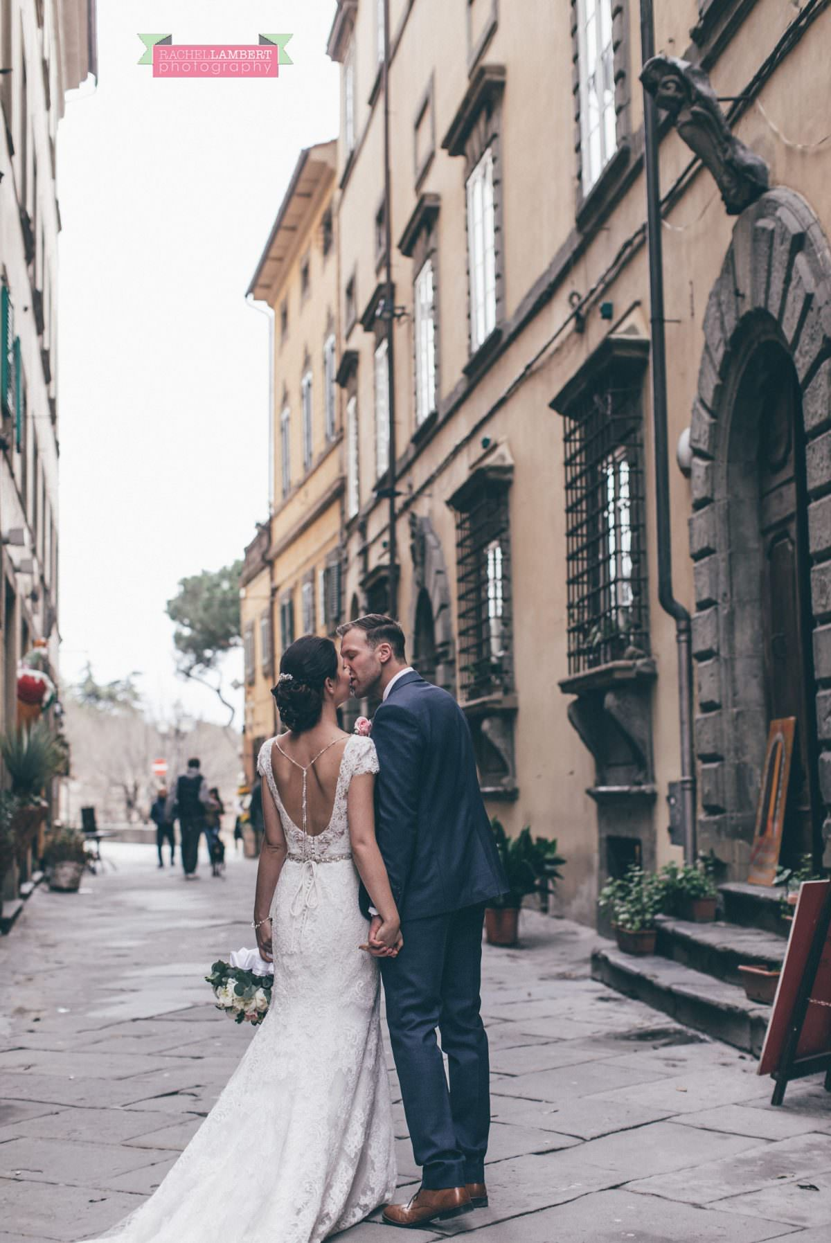 bride and groom portrait wedding in italy colour cortona tuscany walking through street