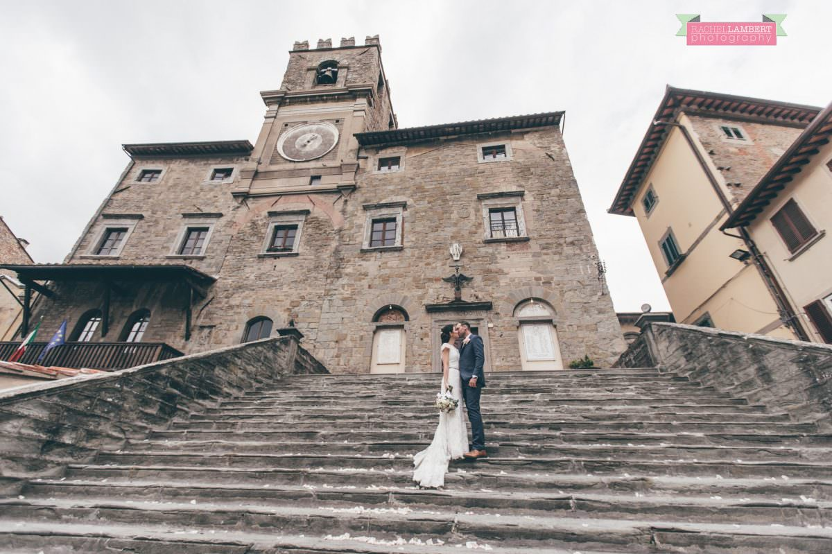 bride and groom portrait wedding in italy colour cortona tuscany town hall steps