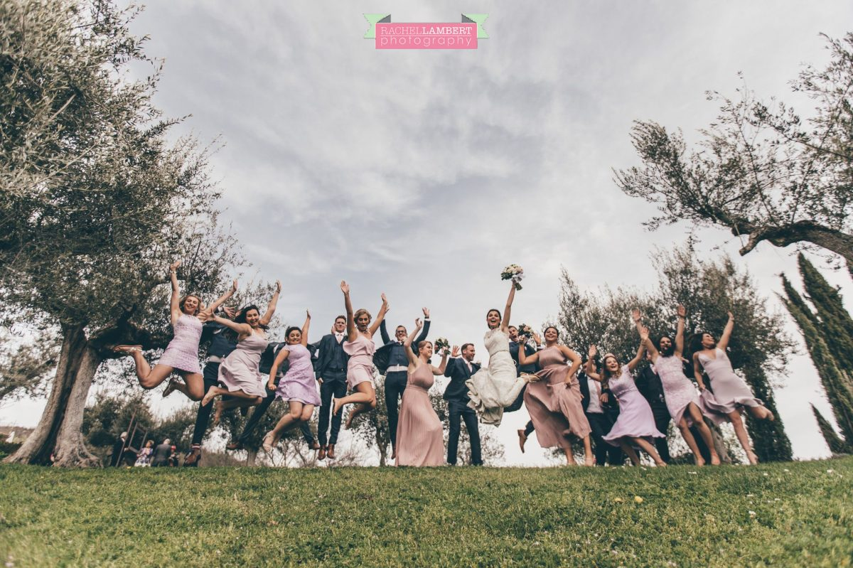 bride and groom bridal party group shots wedding in italy jumping