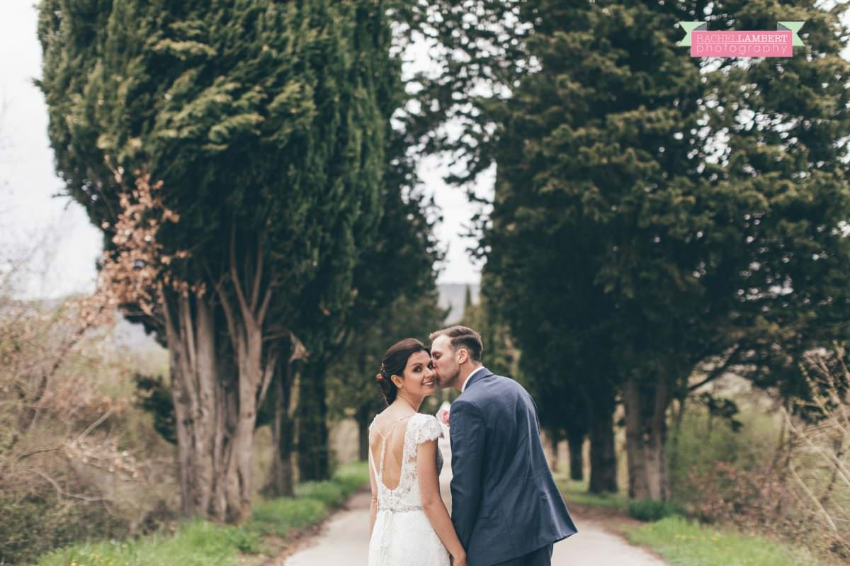 bride and groom portrait wedding in italy colour cortona tuscany cyprus trees