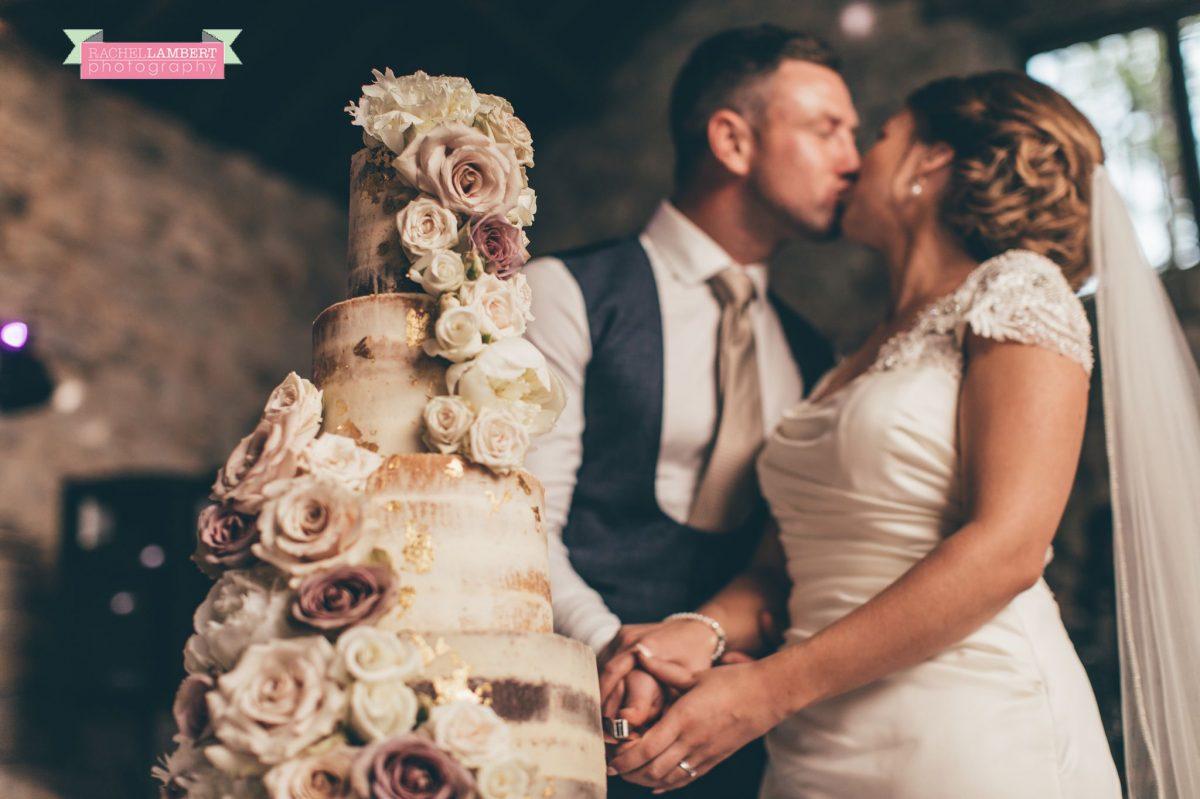 rachel lambert photography bride and groom pencoed house cutting the cake