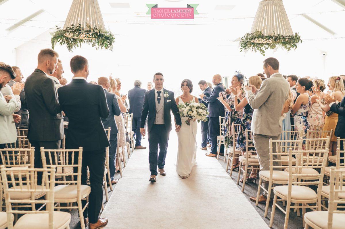 Rachel Lambert Photography llanerch vineyard wedding photographer bride and groom walking down the aisle