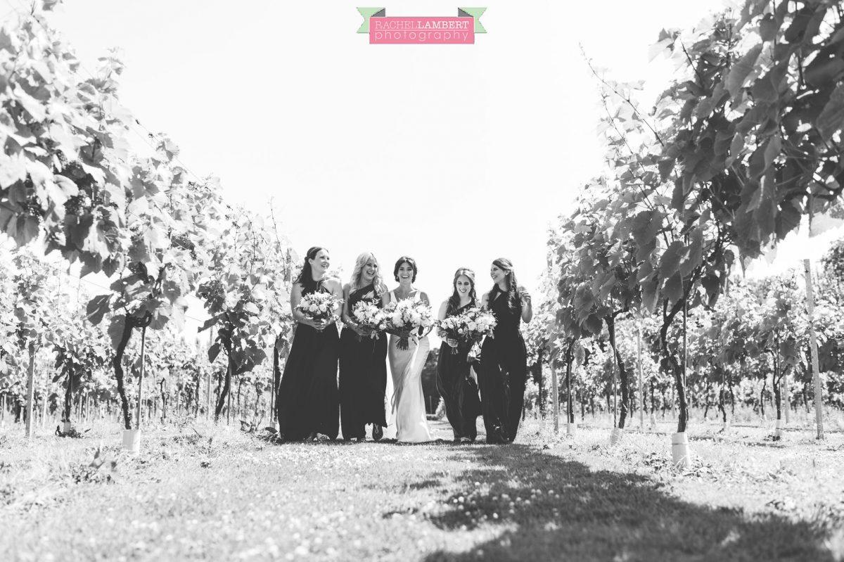 Rachel Lambert Photography llanerch vineyard wedding photographer bride with bridesmaids walking