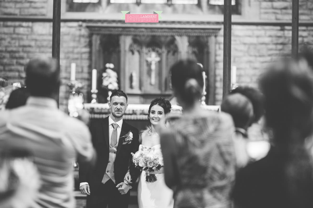 olwalls wedding photographer rachel lambert photography bride and groom in st peters church newton