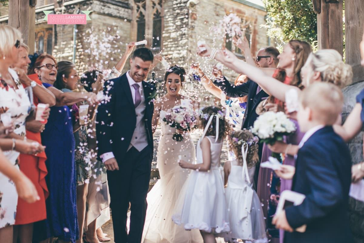 olwalls wedding photographer rachel lambert photography bride and groom in st peters church newton confetti