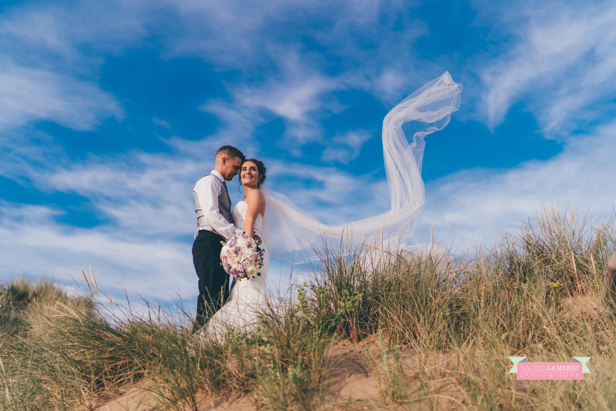 olwalls wedding photographer rachel lambert photography bride and groom llangennith beach golden hour long veil shot