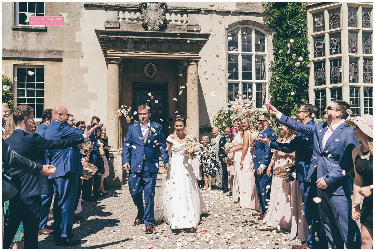 elmore court wedding photographer bride and groom confetti shot
