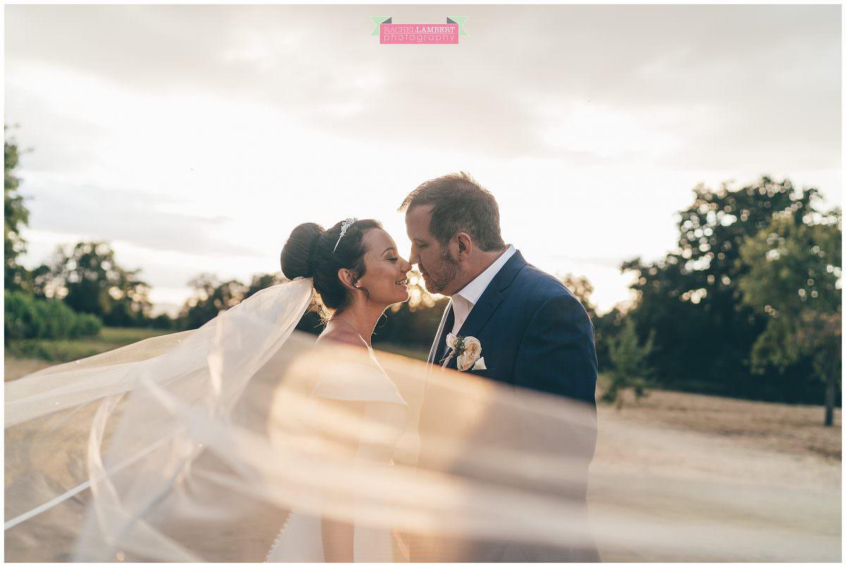 elmore court wedding photographer veil shot bride and groom golden hour