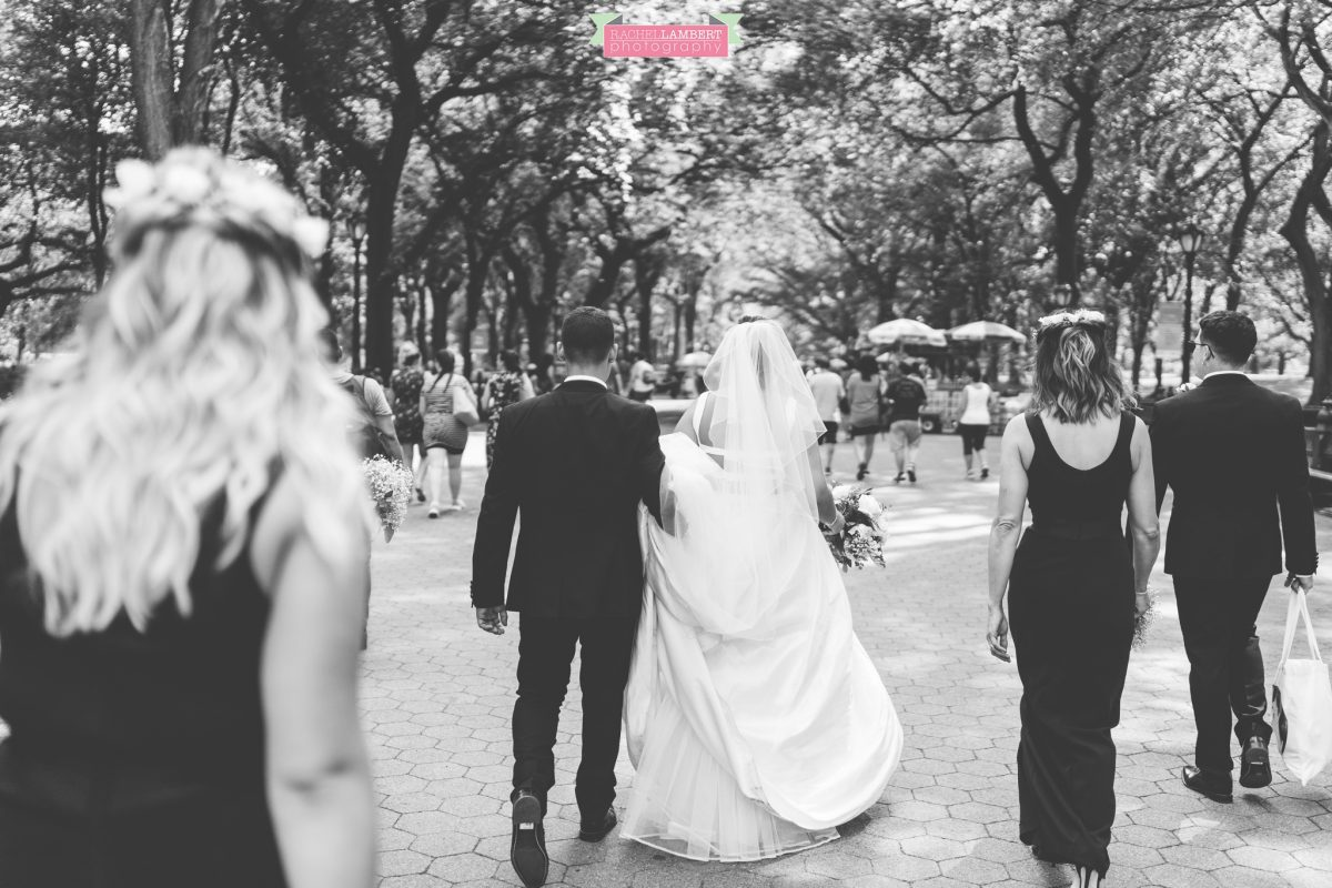 rachel lambert photography new york wedding photos bride and groom wedding party walking through central park