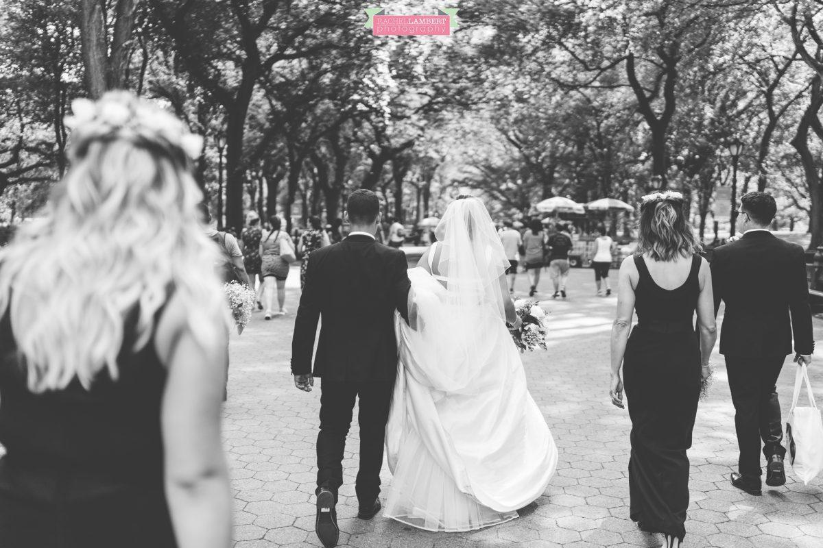rachel lambert photography new york wedding photos bride and groom wedding party walking through central park