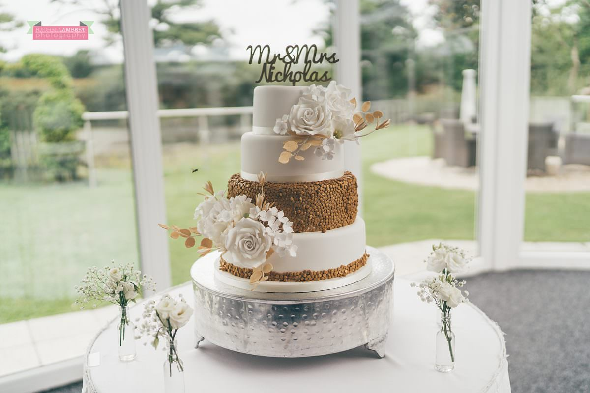 oldwalls wedding photographer bride and groom cake