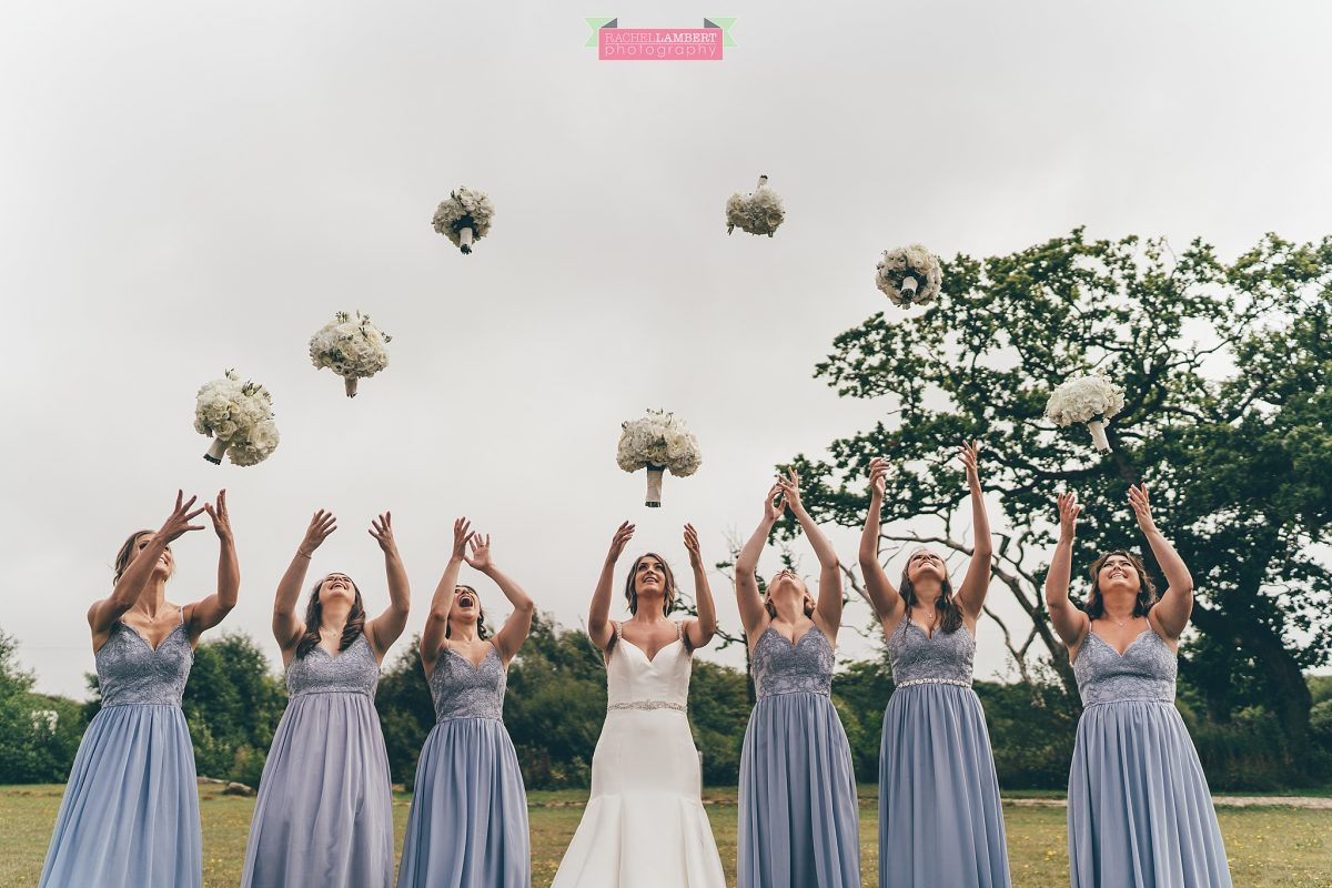 oldwalls wedding photographer bride and bridesmaids throwing bouquets