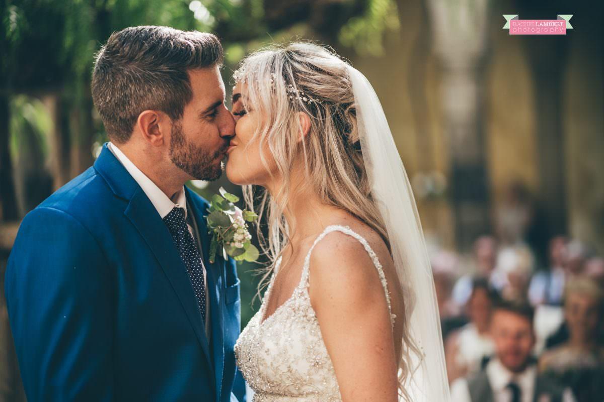 wedding photographer sorrento italy bride and groom chiostro di san francesco laura may bridal first kiss