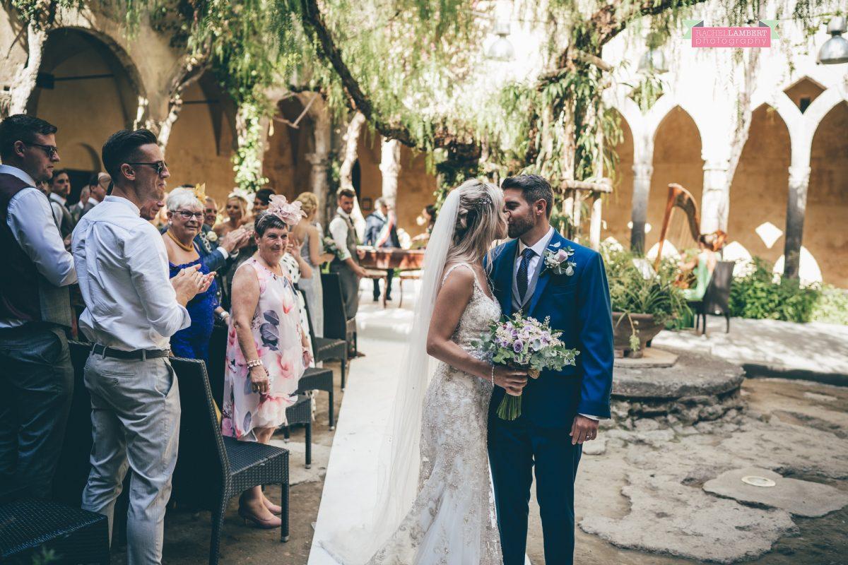 wedding photographer sorrento italy bride and groom chiostro di san francesco laura may bridal walking down the aisle