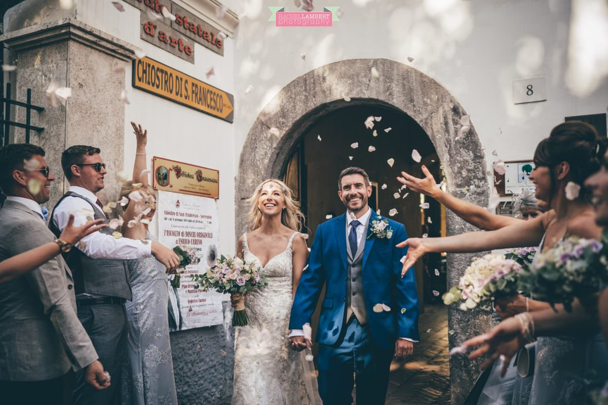 wedding photographer sorrento italy bride and groom chiostro di san francesco laura may bridal confetti