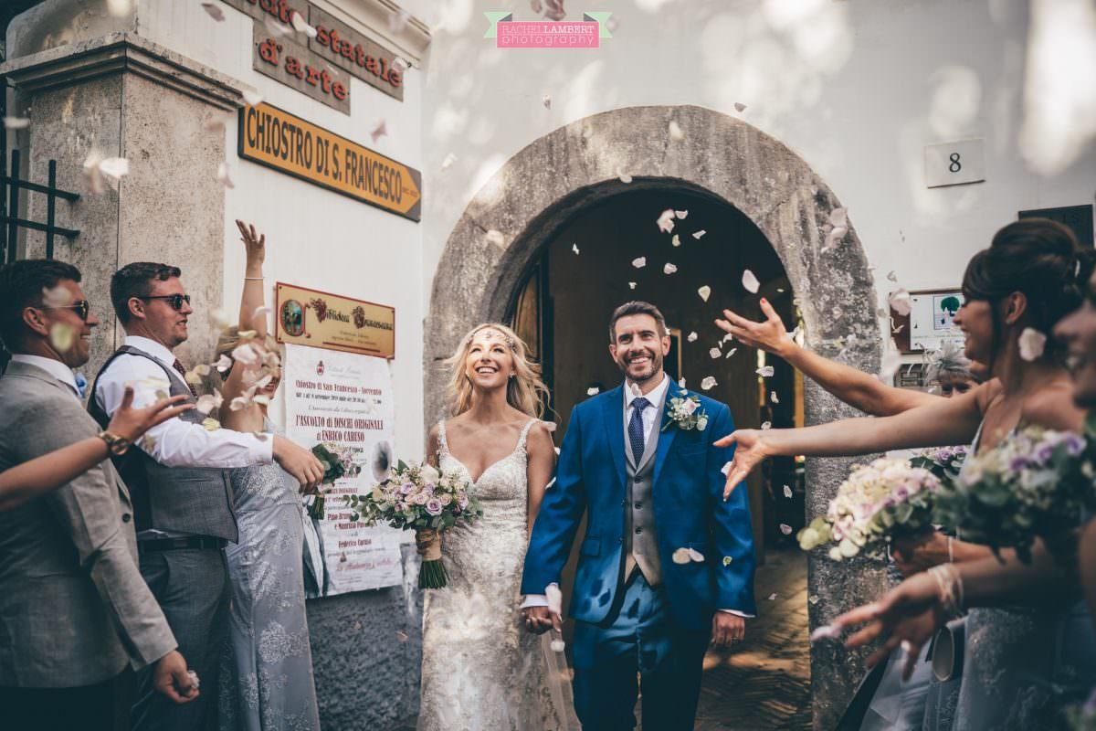 wedding photographer sorrento italy bride and groom chiostro di san francesco laura may bridal confetti