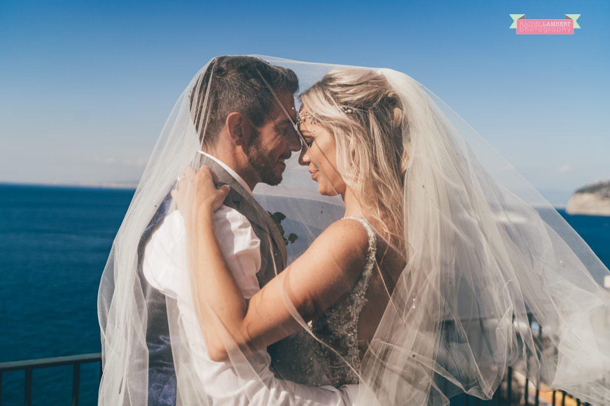 wedding photographer sorrento italy bride and groom chiostro di san francesco long veil