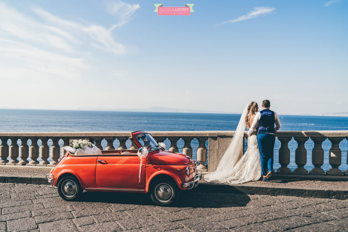 wedding photographer sorrento italy bride and groom mount vesuvius views amalfi red fiat