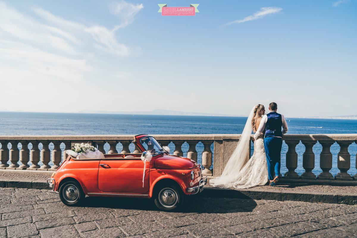 wedding photographer sorrento italy bride and groom mount vesuvius views amalfi red fiat