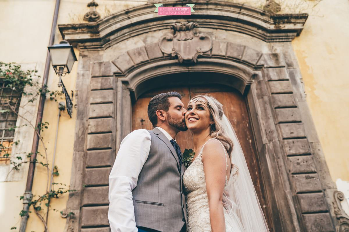 wedding photographer sorrento italy bride and groom italian door