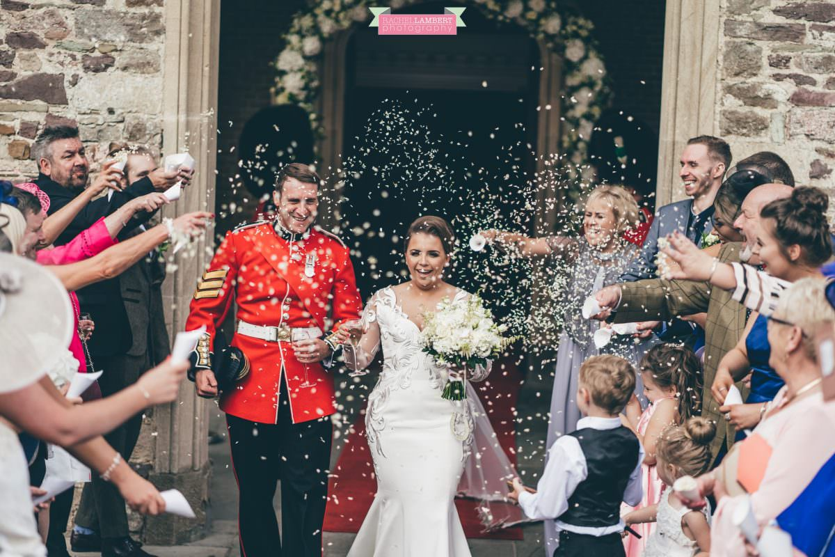 hensol castle wedding photographer bride and groom confetti