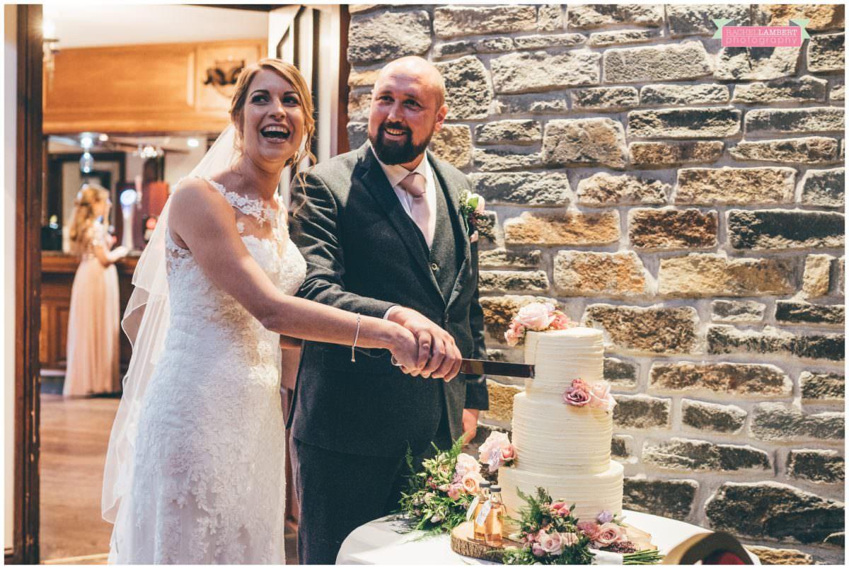 cardiff wedding photographer miskin manor rachel lambert photography cutting the cake