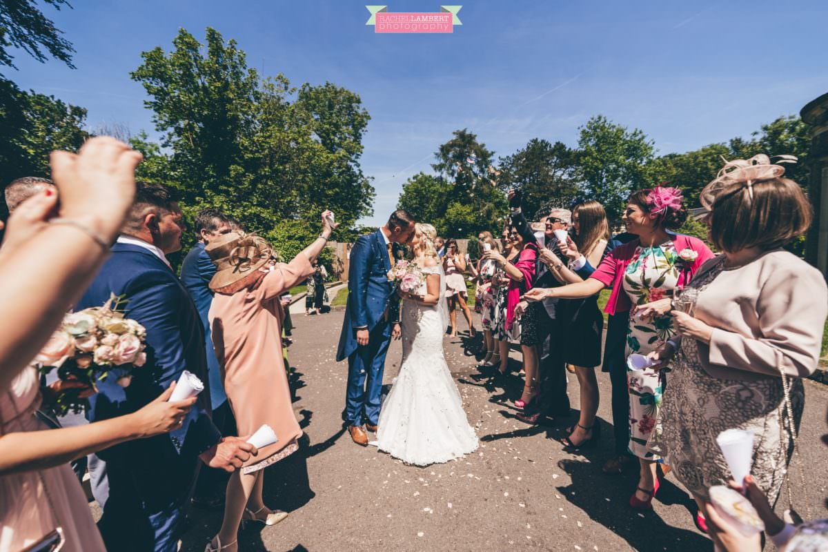 rachel lambert photography decourcey's manor wedding photographer bride and groom confetti